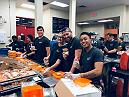 Las Vegas, NV. UFC employees pose for a picture at Three Square Food Bank during Walk The Walk.