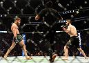 LAS VEGAS, NV - OCTOBER 06:  Khabib Nurmagomedov of Russia (R) and Conor McGregor of Ireland (L) start their UFC lightweight championship bout during the UFC 229 event inside T-Mobile Arena on October 6, 2018 in Las Vegas, Nevada.  (Photo by Harry How/Getty Images)