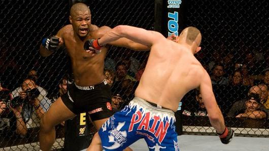 Rashad Evans punches <a href='../fighter/Chuck-Liddell'>Chuck Liddell</a> in what is one of the most iconic finishes in UFC history