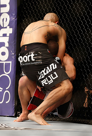 LAS VEGAS, NV - DECEMBER 29:  John Moraga (black shorts) attempts to submit Chris Cariaso during their flyweight fight at UFC 155 on December 29, 2012 at MGM Grand Garden Arena in Las Vegas, Nevada. (Photo by Josh Hedges/Zuffa LLC/Zuffa LLC via Getty Images) *** Local Caption *** Chris Cariaso; John Moraga