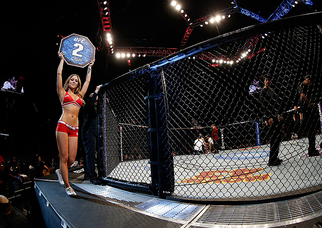 LAS VEGAS, NV - DECEMBER 29:  Octagon Girl Brittney Palmer announces round two of the Cariaso vs Moraga flyweight fight at UFC 155 on December 29, 2012 at MGM Grand Garden Arena in Las Vegas, Nevada. (Photo by Josh Hedges/Zuffa LLC/Zuffa LLC via Getty Images) *** Local Caption *** Brittney Palmer