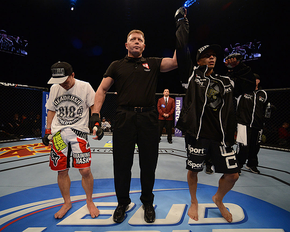 LAS VEGAS, NV - DECEMBER 29:  John Moraga (right) is declared the winner over Chris Cariaso (left) after their flyweight fight at UFC 155 on December 29, 2012 at MGM Grand Garden Arena in Las Vegas, Nevada. (Photo by Donald Miralle/Zuffa LLC/Zuffa LLC via Getty Images) *** Local Caption *** Chris Cariaso; John Moraga