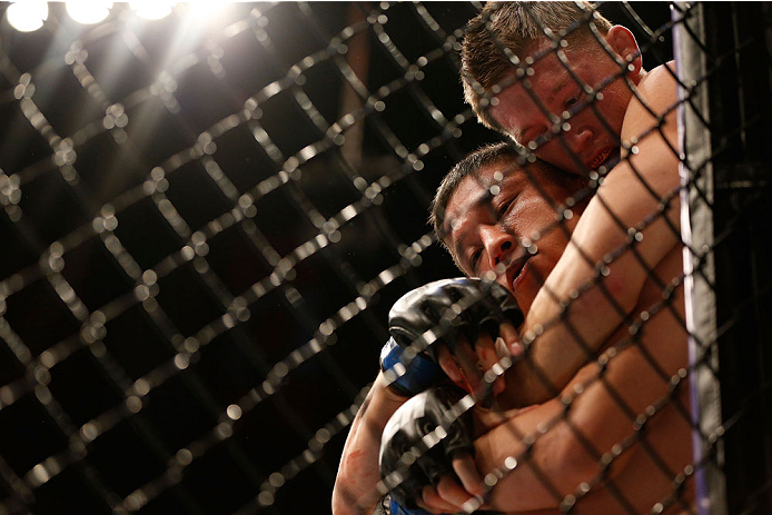 HOUSTON, TEXAS - OCTOBER 19:  (L-R) Kyoji Horiguchi is held in a choke hold by Dustin Pague in their UFC bantamweight bout at the Toyota Center on October 19, 2013 in Houston, Texas. (Photo by Josh Hedges/Zuffa LLC/Zuffa LLC via Getty Images)