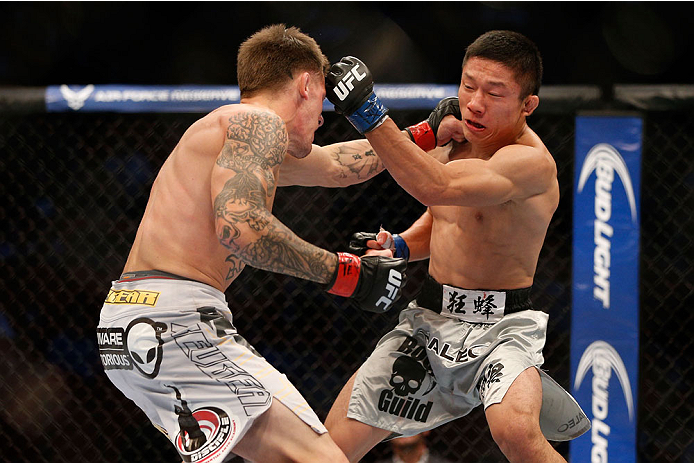 HOUSTON, TEXAS - OCTOBER 19:  (L-R) Dustin Pague punches Kyoji Horiguchi in their UFC bantamweight bout at the Toyota Center on October 19, 2013 in Houston, Texas. (Photo by Josh Hedges/Zuffa LLC/Zuffa LLC via Getty Images)