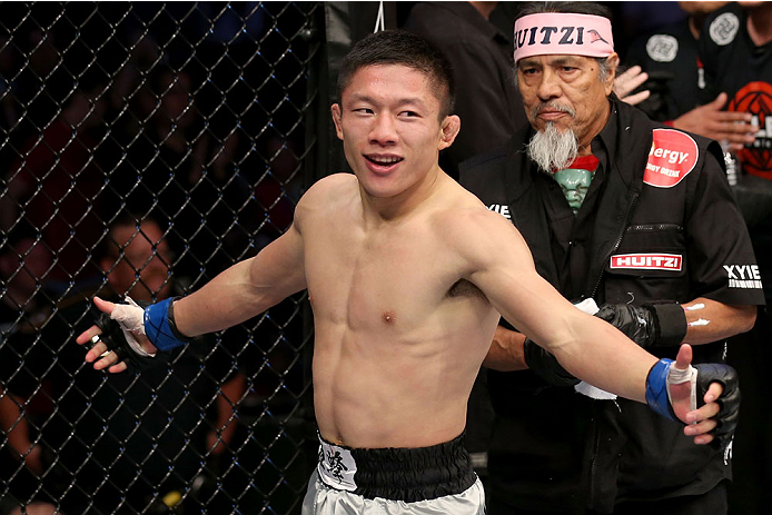 HOUSTON, TEXAS - OCTOBER 19:  Kyoji Horiguchi celebrates after defeating Dustin Pague by TKO in their UFC bantamweight bout at the Toyota Center on October 19, 2013 in Houston, Texas. (Photo by Nick Laham/Zuffa LLC/Zuffa LLC via Getty Images)