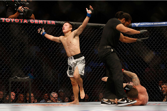 HOUSTON, TEXAS - OCTOBER 19:  (L-R) Kyoji Horiguchi celebrates after defeating Dustin Pague by TKO in their UFC bantamweight bout at the Toyota Center on October 19, 2013 in Houston, Texas. (Photo by Josh Hedges/Zuffa LLC/Zuffa LLC via Getty Images)