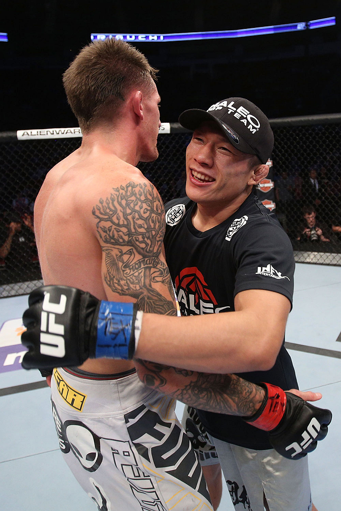 HOUSTON, TEXAS - OCTOBER 19:  Kyoji Horiguchi (R) is congratulated by Dustin Pague (L) after their UFC bantamweight bout at the Toyota Center on October 19, 2013 in Houston, Texas. Kyoji Horiguchi won by TKO. (Photo by Nick Laham/Zuffa LLC/Zuffa LLC via Getty Images)