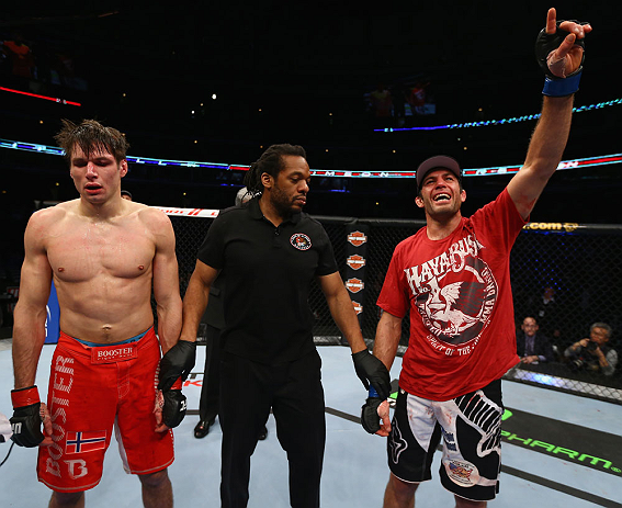 CHICAGO, IL - JANUARY 26:  David Mitchell (R) celebrates after defeating Simeon Thoresen (L) during their Welterweight Bout part of Facebook Prelims at United Center on January 26, 2013 in Chicago, Illinois.  (Photo by Al Bello/Zuffa LLC/Zuffa LLC Via Getty Images)
