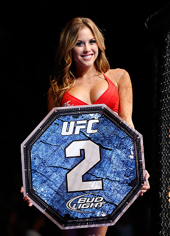 SEATTLE, WA - JULY 27: UFC Octagon Girl Brittney Palmer introduces round two of Albert vs Meza during their bantamweight bout during the UFC on FOX event at Key Arena on July 27, 2013 in Seattle, Washington. (Photo by Josh Hedges/Zuffa LLC/Zuffa LLC via Getty Images) *** Local Caption *** Brittney Palmer
