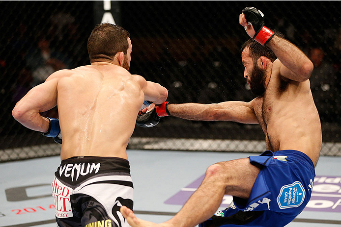 SACRAMENTO, CA - DECEMBER 14:  (L-R) Alptekin Ozkilic punches Darren Uyenoyama in their flyweight bout during the UFC on FOX event at Sleep Train Arena on December 14, 2013 in Sacramento, California. (Photo by Josh Hedges/Zuffa LLC/Zuffa LLC via Getty Images) *** Local Caption *** Darren Uyenoyama; Alptekin Ozkilic