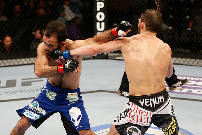 SACRAMENTO, CA - DECEMBER 14:  (R-L) Alptekin Ozkilic punches Darren Uyenoyama in their flyweight bout during the UFC on FOX event at Sleep Train Arena on December 14, 2013 in Sacramento, California. (Photo by Josh Hedges/Zuffa LLC/Zuffa LLC via Getty Images) *** Local Caption *** Darren Uyenoyama; Alptekin Ozkilic