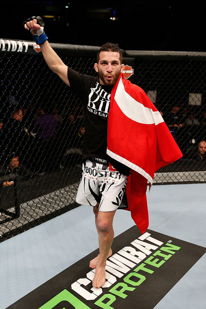 SACRAMENTO, CA - DECEMBER 14:  Alptekin Ozkilic reacts to his victory over Darren Uyenoyama in their flyweight bout during the UFC on FOX event at Sleep Train Arena on December 14, 2013 in Sacramento, California. (Photo by Josh Hedges/Zuffa LLC/Zuffa LLC via Getty Images) *** Local Caption *** Alptekin Ozkilic