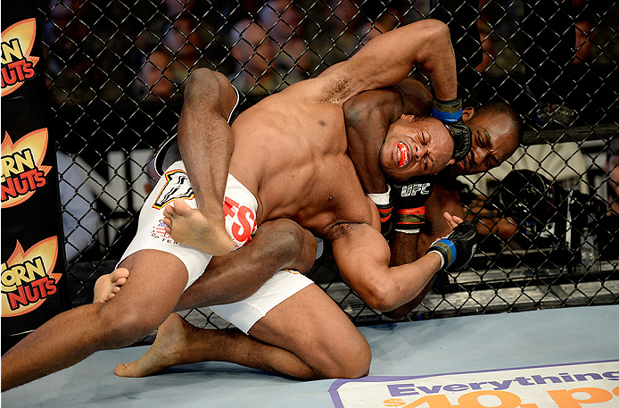 FORT CAMPBELL, KENTUCKY - NOVEMBER 6:  Derek Brunson (right) attempts to submit Brian Houston with a guillotine choke in their UFC middleweight bout on November 6, 2013 in Fort Campbell, Kentucky. (Photo by Jeff Bottari/Zuffa LLC/Zuffa LLC via Getty Images) *** Local Caption ***Brian Houston; Derek Brunson