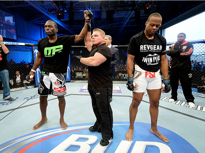 FORT CAMPBELL, KENTUCKY - NOVEMBER 6:  Derek Brunson (left) is declared the winner over Brian Houston (right) in their UFC middleweight bout on November 6, 2013 in Fort Campbell, Kentucky. (Photo by Jeff Bottari/Zuffa LLC/Zuffa LLC via Getty Images) *** Local Caption ***Brian Houston; Derek Brunson