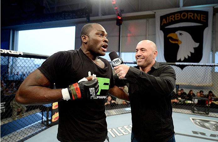 FORT CAMPBELL, KENTUCKY - NOVEMBER 6:  (R-L) Joe Rogan interviews Derek Brunson after his victory over Brian Houston in their UFC middleweight bout on November 6, 2013 in Fort Campbell, Kentucky. (Photo by Jeff Bottari/Zuffa LLC/Zuffa LLC via Getty Images) *** Local Caption ***Brian Houston; Derek Brunson