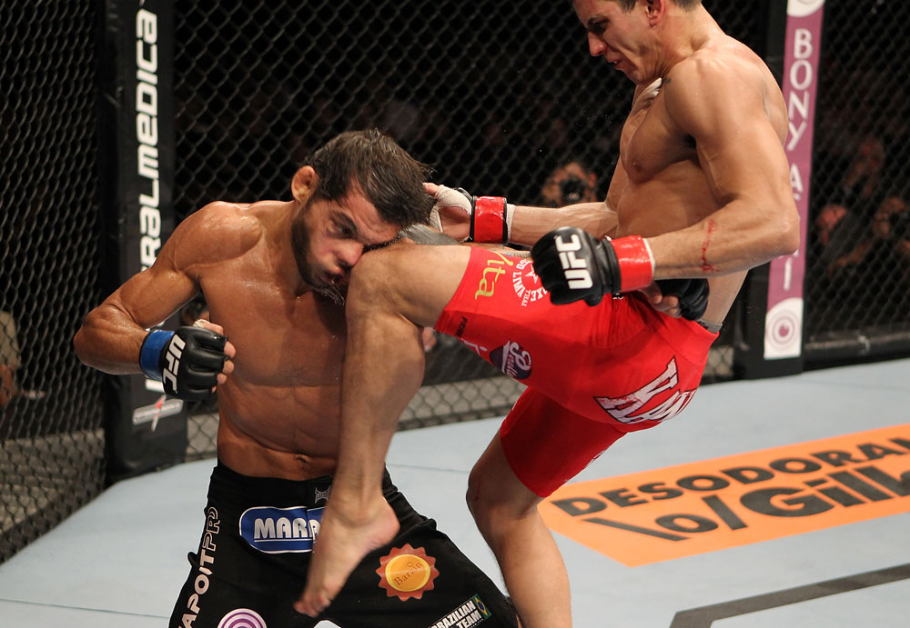 BELO HORIZONTE, BRAZIL - JUNE 23:   (R-L) Felipe Arantes lands a flying knee against Milton Vieira  during their UFC 147 featherweight bout at Estadio Jornalista Felipe Drummond on June 23, 2012 in Belo Horizonte, Brazil.  (Photo by Josh Hedges/Zuffa LLC/Zuffa LLC via Getty Images)