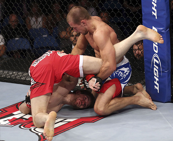 CALGARY, CANADA - JULY 21: (L-R) Mitch Clarke gets flipped by Anton Kuivanen during their lightweight bout at UFC 149 inside the Scotiabank Saddledome on July 21, 2012 in Calgary, Alberta, Canada.  (Photo by Nick Laham/Zuffa LLC/Zuffa LLC via Getty Images)