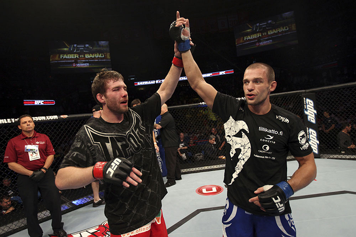 CALGARY, CANADA - JULY 21: (L-R) Mitch Clarke congratulates Anton Kuivanen after their lightweight bout at UFC 149 inside the Scotiabank Saddledome on July 21, 2012 in Calgary, Alberta, Canada.  (Photo by Nick Laham/Zuffa LLC/Zuffa LLC via Getty Images)
