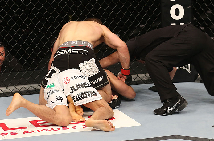 DENVER, CO - AUGUST 11:  Nik Lentz (black shorts) punches down at Eiji Mitsuoka during their featherweight bout at UFC 150 inside Pepsi Center on August 11, 2012 in Denver, Colorado. (Photo by Nick Laham/Zuffa LLC/Zuffa LLC via Getty Images)