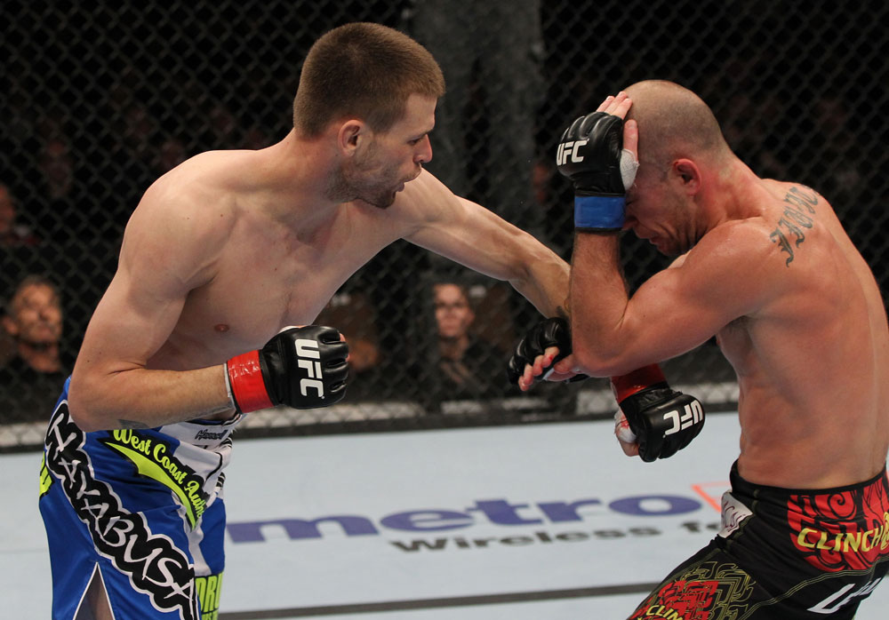 OMAHA, NE - FEBRUARY 15:  (L-R) Tim Means punches Bernardo Magalhaes during the UFC on FUEL TV event at Omaha Civic Auditorium on February 15, 2012 in Omaha, Nebraska.  (Photo by Josh Hedges/Zuffa LLC/Zuffa LLC via Getty Images) *** Local Caption *** Tim Means; Bernardo Magalhaes