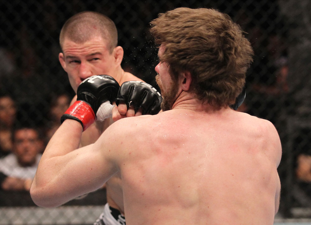TORONTO, ON - DECEMBER 10:  (L-R) John Cholish punches Mitch Clarke during the UFC 140 event at Air Canada Centre on December 10, 2011 in Toronto, Canada.  (Photo by Nick Laham/Zuffa LLC/Zuffa LLC)