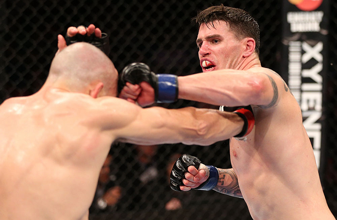 RIO DE JANEIRO, BRAZIL - OCTOBER 13:  (R-L) Chris Camozzi punches Luiz Cane during their middleweight fight at UFC 153 inside HSBC Arena on October 13, 2012 in Rio de Janeiro, Brazil.  (Photo by Josh Hedges/Zuffa LLC/Zuffa LLC via Getty Images)