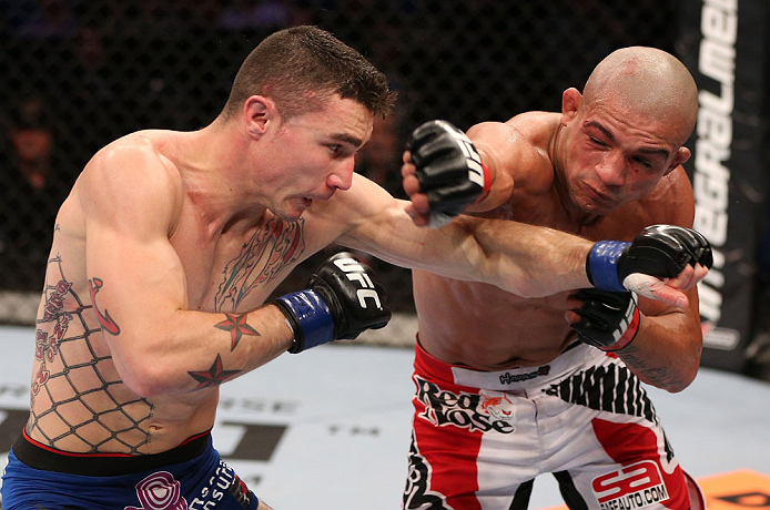RIO DE JANEIRO, BRAZIL - OCTOBER 13:  (R-L) Diego Brandao punches Joey Gambino during their featherweight fight at UFC 153 inside HSBC Arena on October 13, 2012 in Rio de Janeiro, Brazil.  (Photo by Josh Hedges/Zuffa LLC/Zuffa LLC via Getty Images)