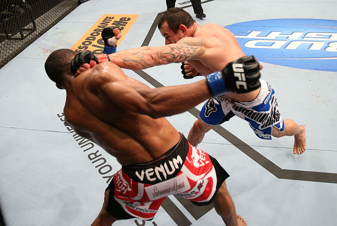RIO DE JANEIRO, BRAZIL - OCTOBER 13:  (R-L) Gleison Tibau punches Francisco Trinaldo during their lightweight fight at UFC 153 inside HSBC Arena on October 13, 2012 in Rio de Janeiro, Brazil.  (Photo by Josh Hedges/Zuffa LLC/Zuffa LLC via Getty Images)