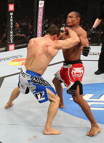 RIO DE JANEIRO, BRAZIL - OCTOBER 13:  (L-R) Gleison Tibau punches Francisco Trinaldo during their lightweight fight at UFC 153 inside HSBC Arena on October 13, 2012 in Rio de Janeiro, Brazil.  (Photo by Josh Hedges/Zuffa LLC/Zuffa LLC via Getty Images)