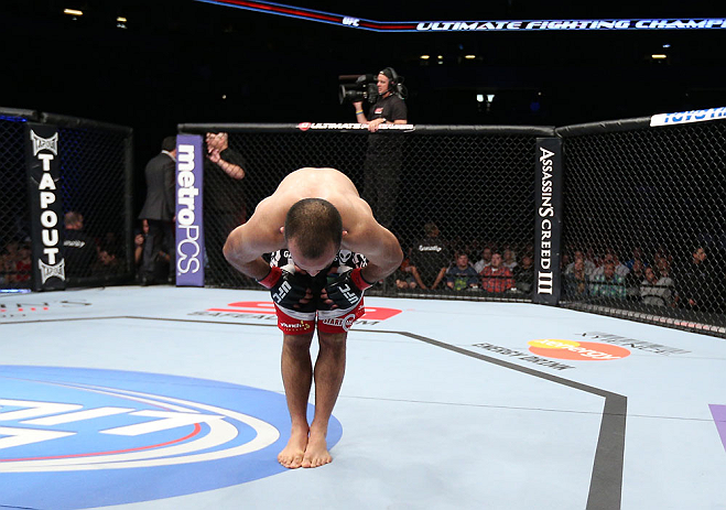 MINNEAPOLIS, MN - OCTOBER 05:  Darren Uyenoyama reacts after defeating Phil Harris during their flyweight fight at the UFC on FX event at Target Center on October 5, 2012 in Minneapolis, Minnesota.  (Photo by Josh Hedges/Zuffa LLC/Zuffa LLC via Getty Images)