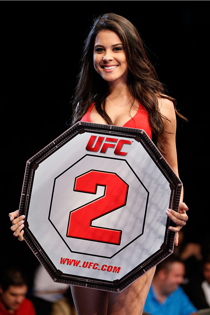BELO HORIZONTE, BRAZIL - SEPTEMBER 04:  UFC Octagon Girl Camila Rodrigues de Oliveira introduces a round during the UFC on FOX Sports 1 event at Mineirinho Arena on September 4, 2013 in Belo Horizonte, Brazil. (Photo by Josh Hedges/Zuffa LLC/Zuffa LLC via Getty Images)
