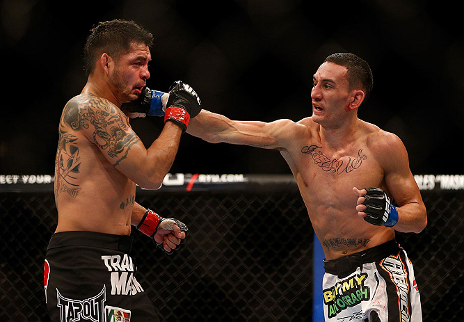 LAS VEGAS, NV - DECEMBER 29:  (R-L) Max Holloway punches Leonard Garcia during their featherweight fight at UFC 155 on December 29, 2012 at MGM Grand Garden Arena in Las Vegas, Nevada. (Photo by Josh Hedges/Zuffa LLC/Zuffa LLC via Getty Images) *** Local Caption *** Leonard Garcia; Max Holloway