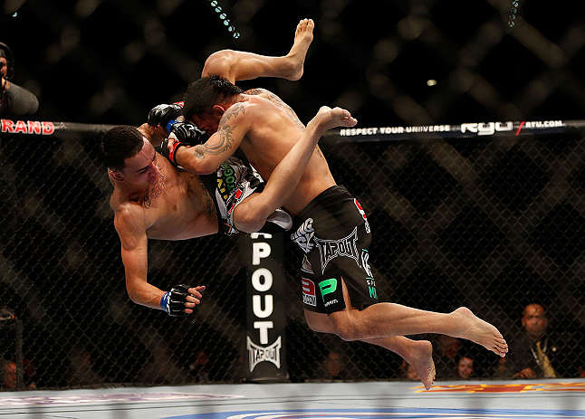 LAS VEGAS, NV - DECEMBER 29:  (R-L) Leonard Garcia slams Max Holloway during their featherweight fight at UFC 155 on December 29, 2012 at MGM Grand Garden Arena in Las Vegas, Nevada. (Photo by Josh Hedges/Zuffa LLC/Zuffa LLC via Getty Images) *** Local Caption *** Leonard Garcia; Max Holloway