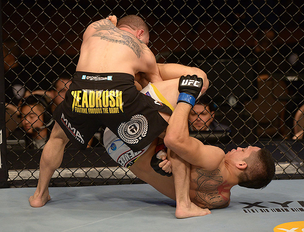 LAS VEGAS, NV - FEBRUARY 02:  (R-L) Dustin Kimura attempts to submit Chico Camus during their bantamweight fight at UFC 156 on February 2, 2013 at the Mandalay Bay Events Center in Las Vegas, Nevada.  (Photo by Donald Miralle/Zuffa LLC/Zuffa LLC via Getty Images) *** Local Caption *** Chico Camus; Dustin Kimura