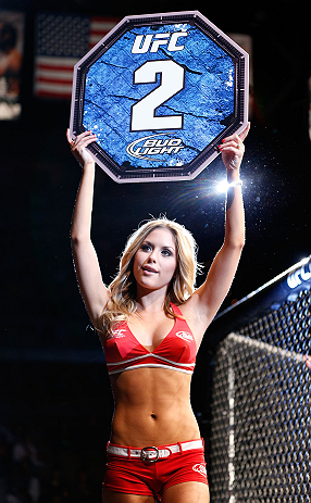 LAS VEGAS, NV - FEBRUARY 02:  UFC Octagon Girl Brittney Palmer introduces round two of Chico Camus and Dustin Kimura&#39;s bantamweight fight at UFC 156 on February 2, 2013 at the Mandalay Bay Events Center in Las Vegas, Nevada.  (Photo by Josh Hedges/Zuffa LLC/Zuffa LLC via Getty Images) *** Local Caption *** Chico Camus; Dustin Kimura