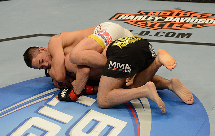LAS VEGAS, NV - FEBRUARY 02:  Dustin Kimura (top) attempts to submit Chico Camus during their bantamweight fight at UFC 156 on February 2, 2013 at the Mandalay Bay Events Center in Las Vegas, Nevada.  (Photo by Donald Miralle/Zuffa LLC/Zuffa LLC via Getty Images) *** Local Caption *** Chico Camus; Dustin Kimura