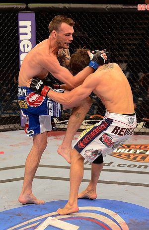 LAS VEGAS, NV - MAY 25:   (L-R) George Roop knees Brian Bowles in their bantamweight bout during UFC 160 at the MGM Grand Garden Arena on May 25, 2013 in Las Vegas, Nevada.  (Photo by Donald Miralle/Zuffa LLC/Zuffa LLC via Getty Images)  *** Local Caption *** Brian Bowles; George Roop