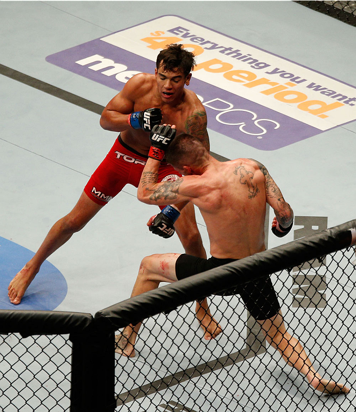 HOUSTON, TEXAS - OCTOBER 19:  (L-R) Andre Fili kicks Jeremy Larsen in their UFC featherweight bout at the Toyota Center on October 19, 2013 in Houston, Texas. (Photo by Josh Hedges/Zuffa LLC/Zuffa LLC via Getty Images)