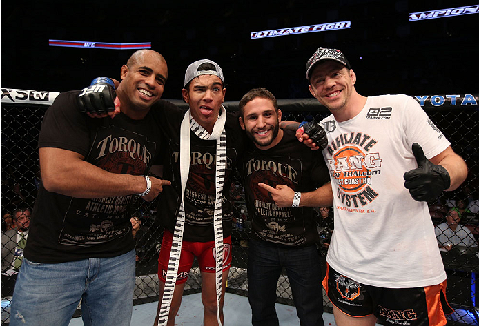 HOUSTON, TEXAS - OCTOBER 19:  Andre Fili (2nd L) celebrates with Chad Mendes (2nd R) and his corner after defeating Jeremy Larsen (not pictured) in their UFC featherweight bout at the Toyota Center on October 19, 2013 in Houston, Texas. (Photo by Nick Laham/Zuffa LLC/Zuffa LLC via Getty Images)