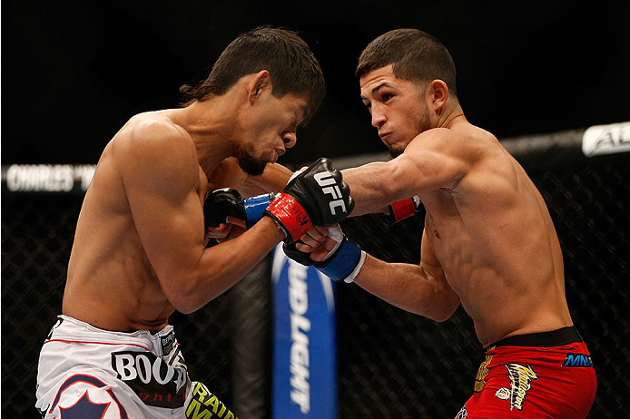LAS VEGAS, NV - NOVEMBER 16:  (R-L) Sergio Pettis punches Will Campuzano in their bantamweight bout during the UFC 167 event inside the MGM Grand Garden Arena on November 16, 2013 in Las Vegas, Nevada. (Photo by Josh Hedges/Zuffa LLC/Zuffa LLC via Getty Images) *** Local Caption *** Will Campuzano; Sergio Pettis