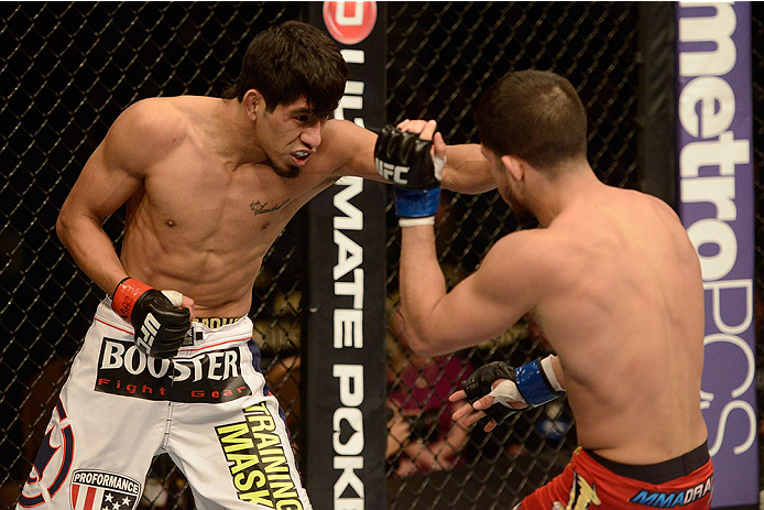 LAS VEGAS, NV - NOVEMBER 16:  (L-R) Will Campuzano punches Sergio Pettis in their bantamweight bout during the UFC 167 event inside the MGM Grand Garden Arena on November 16, 2013 in Las Vegas, Nevada. (Photo by Donald Miralle/Zuffa LLC/Zuffa LLC via Getty Images) *** Local Caption *** Will Campuzano; Sergio Pettis