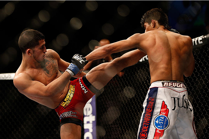 LAS VEGAS, NV - NOVEMBER 16:  (L-R) Sergio Pettis kicks Will Campuzano in their bantamweight bout during the UFC 167 event inside the MGM Grand Garden Arena on November 16, 2013 in Las Vegas, Nevada. (Photo by Josh Hedges/Zuffa LLC/Zuffa LLC via Getty Images) *** Local Caption *** Will Campuzano; Sergio Pettis
