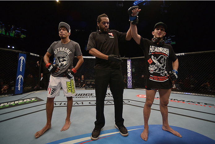 LAS VEGAS, NV - NOVEMBER 16:  Sergio Pettis (right) is declared the winner over Will Campuzano (left) in their bantamweight bout during the UFC 167 event inside the MGM Grand Garden Arena on November 16, 2013 in Las Vegas, Nevada. (Photo by Donald Miralle/Zuffa LLC/Zuffa LLC via Getty Images) *** Local Caption *** Will Campuzano; Sergio Pettis