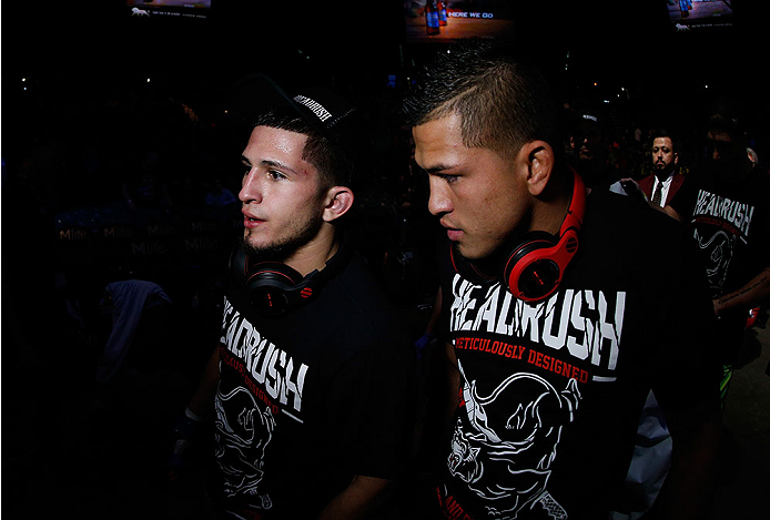 LAS VEGAS, NV - NOVEMBER 16:  (L-R) Sergio Pettis and brother Anthony Pettis walk out of the Octagon during the UFC 167 event inside the MGM Grand Garden Arena on November 16, 2013 in Las Vegas, Nevada. (Photo by Josh Hedges/Zuffa LLC/Zuffa LLC via Getty Images) *** Local Caption *** Anthony Pettis; Sergio Pettis