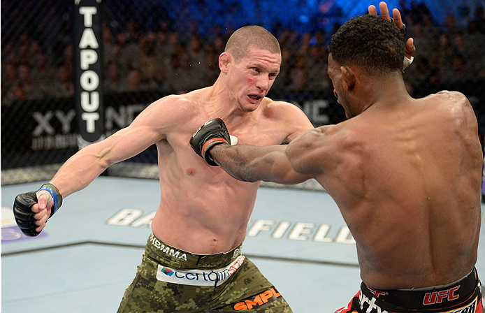 FORT CAMPBELL, KENTUCKY - NOVEMBER 6:  (L-R) Seth Baczynski punches Neil Magny in their UFC welterweight bout on November 6, 2013 in Fort Campbell, Kentucky. (Photo by Jeff Bottari/Zuffa LLC/Zuffa LLC via Getty Images) *** Local Caption ***Neil Magny; Seth Baczynski