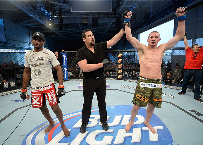 FORT CAMPBELL, KENTUCKY - NOVEMBER 6:  Seth Baczynski (right) is declared the winner over Neil Magny in their UFC welterweight bout on November 6, 2013 in Fort Campbell, Kentucky. (Photo by Jeff Bottari/Zuffa LLC/Zuffa LLC via Getty Images) *** Local Caption ***Neil Magny; Seth Baczynski