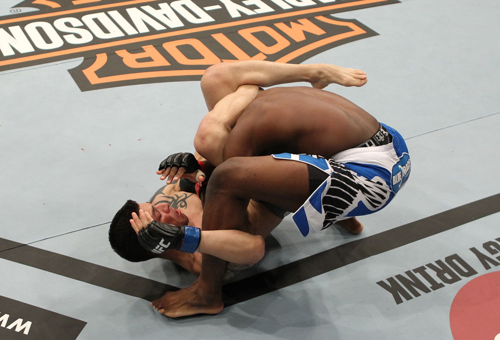 SYDNEY, AUSTRALIA - MARCH 03:  (L-R) Daniel Pineda secures a triangle choke submission hold against Mackens Semerzier during the UFC on FX event at Allphones Arena on March 3, 2012 in Sydney, Australia.  (Photo by Josh Hedges/Zuffa LLC/Zuffa LLC via Getty Images) *** Local Caption *** Mackens Semerzier; Daniel Pineda