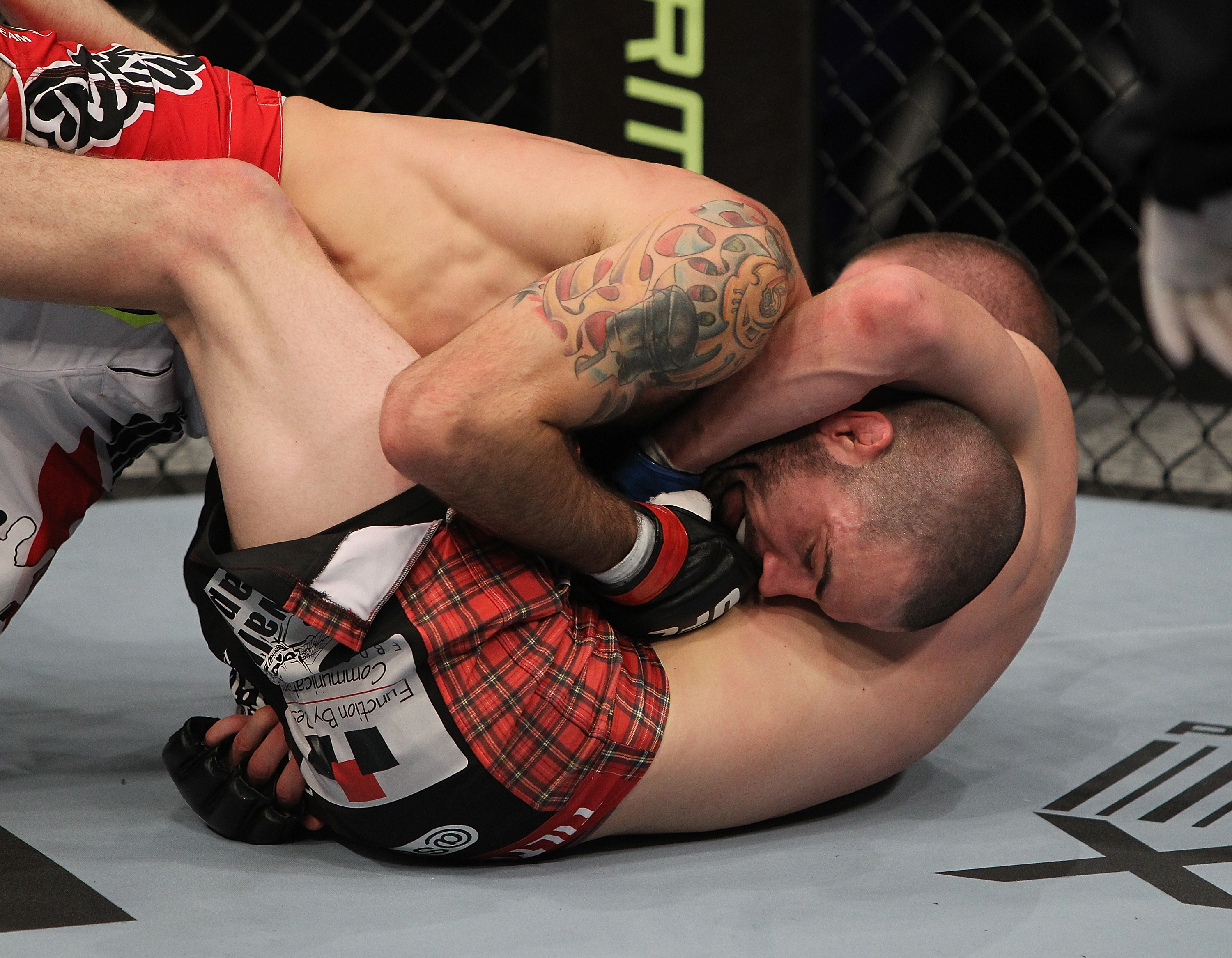 SAN JOSE, CA - NOVEMBER 19: Matt Brown (top) is held in a head-lock by Seth Baczynski (bottom) during an UFC Welterweight bout at the HP Pavillion in San Jose, California on November 19, 2011 in San Jose, California.  (Photo by Josh Hedges/Zuffa LLC/Zuffa LLC via Getty Images)