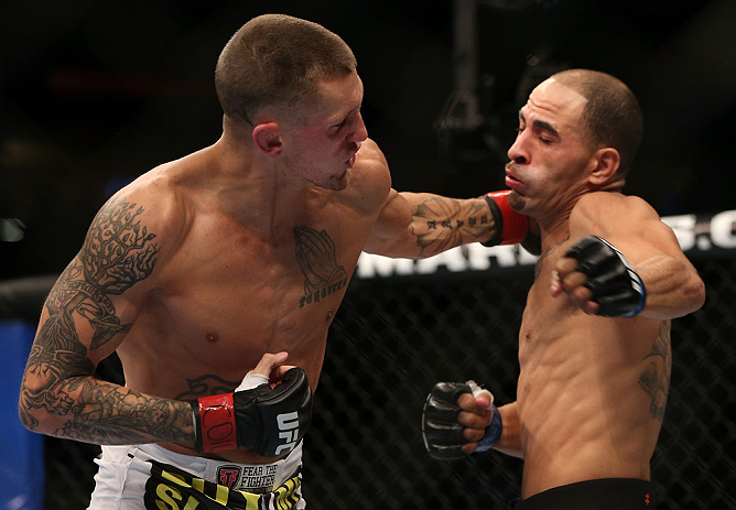 DENVER, CO - AUGUST 11:  (L-R) Dustin Pague punches Chico Camus during their bantamweight bout at UFC 150 inside Pepsi Center on August 11, 2012 in Denver, Colorado. (Photo by Josh Hedges/Zuffa LLC/Zuffa LLC via Getty Images)