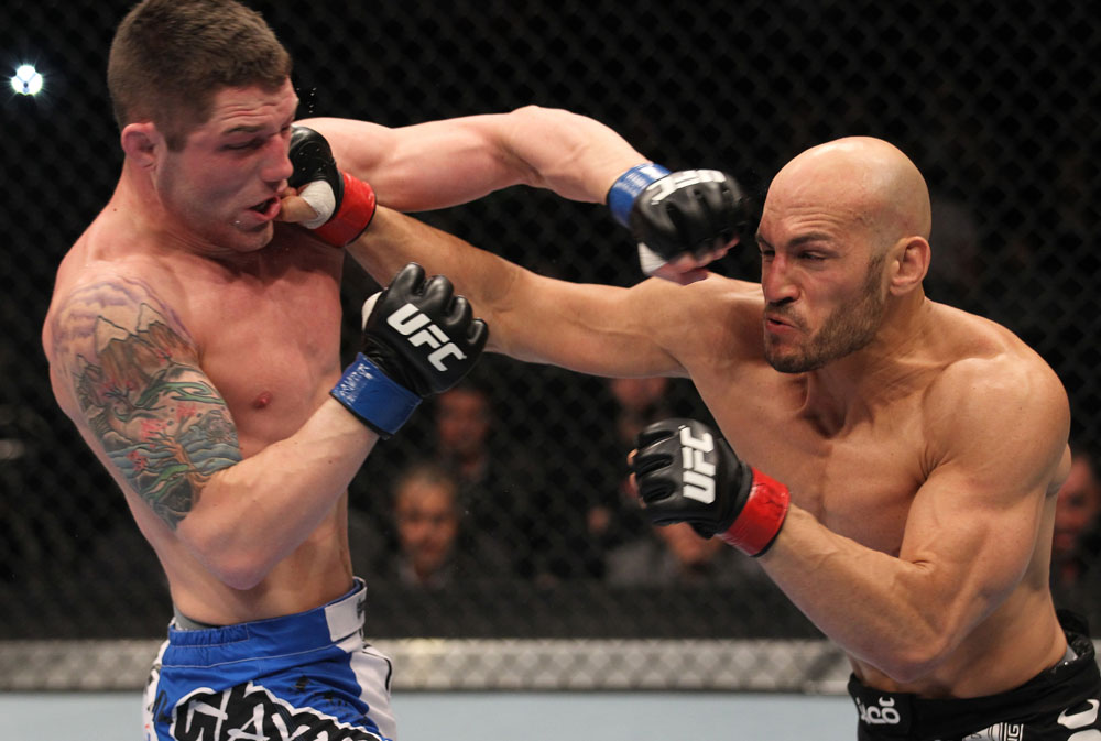TORONTO, ON - DECEMBER 10:  (R-L) Rich Attonito punches Jake Hecht during the UFC 140 event at Air Canada Centre on December 10, 2011 in Toronto, Ontario, Canada.  (Photo by Nick Laham/Zuffa LLC/Zuffa LLC via Getty Images)